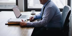 Man working at desk.